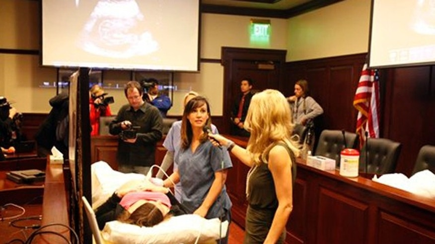 Mar. 21, 2012: Ultrasound technologist Jeanine G. conducts an abdominal ultrasound at the Idaho Statehouse.