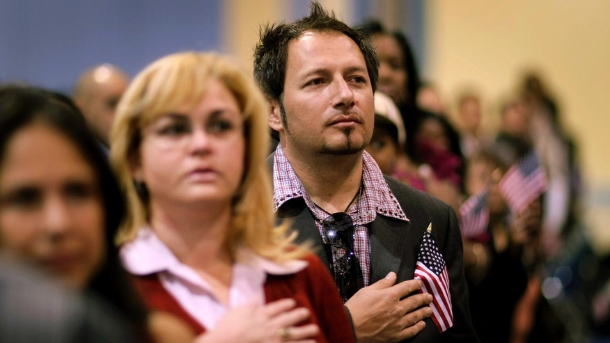 A naturalization ceremony in Miami. (Photo by Joe Raedle/Getty Images)