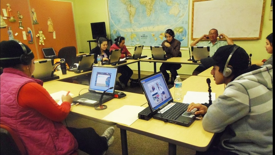 Immigrants practice English using language-learning software at Esperanza Center, one of the many places in Baltimore helping newcomers navigate their new country.