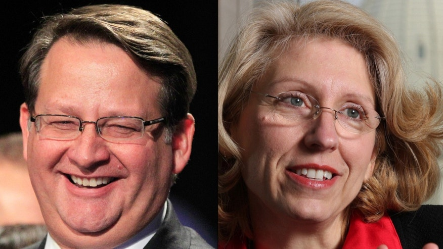 FILE: Undated: Michigan Democratic Rep. Gary Peters and former GOP Michigan Secretary of State Terri Lynn Land, two possible candidates for the open seat of Michigan U.S. Sen. Carl Levin.