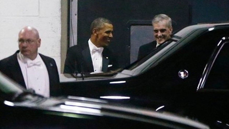 March 9, 2013: President Barack Obama walks with Chief of Staff Denis McDonough, right, as they leave the Gridiron Dinner through a loading area at a hotel in Washington.