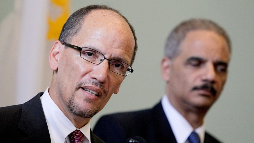 NEW ORLEANS, LA - JULY 24:  Assistant Attorney General for the Civil Rights Division Thomas E. Perez (L) discusses  the Federal Consent Decree with Attorney General Eric Holder at Gallier Hall on July 24, 2012 in New Orleans, Louisiana. The signing of the federal consent decree was designed to clean up a police force that had been plagued by decades of corruption and abuse.(Photo by Sean Gardner/Getty Images)