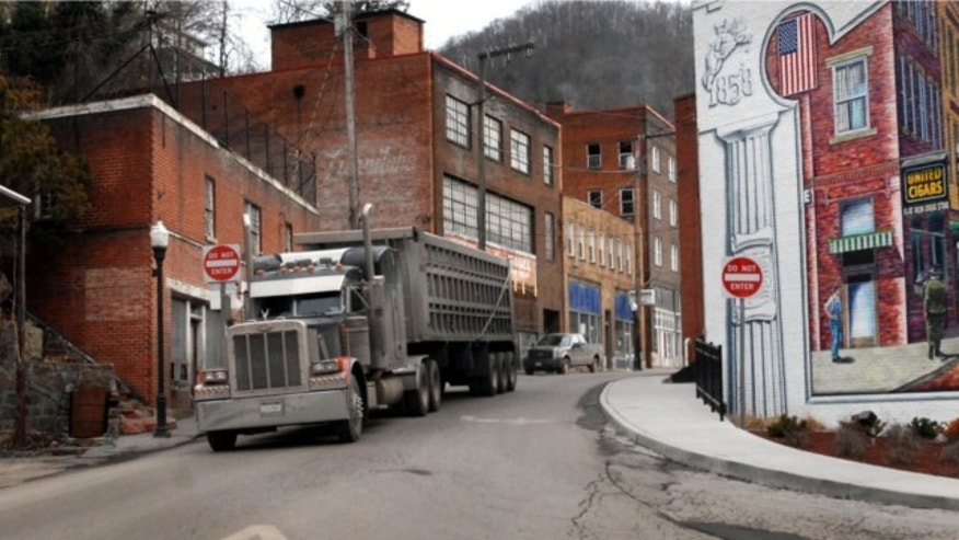 Feb. 9, 2011: A coal truck drives out of downtown Welch, W.Va.