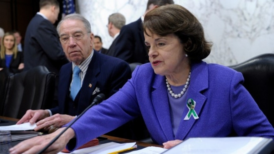 Senate Judiciary Committee member Sen. Dianne Feinstein, D-Calif., right, sits next to the committee's ranking Republican, Sen. Charles Grassley, R-Iowa, at a hearing on Capitol Hill in Washington.