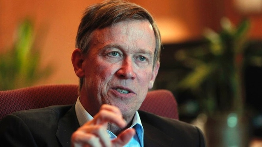 Dec. 12, 2012: In this file photo, Colorado Gov. John Hickenlooper is pictured during an interview with the Associated Press at his office in the Capitol in Denver.