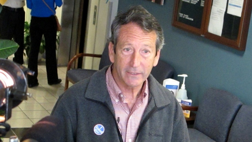 March. 19, 2013: Former South Carolina Gov. Mark Sanford speaks with reporters at a polling place in Charleston, S.C.