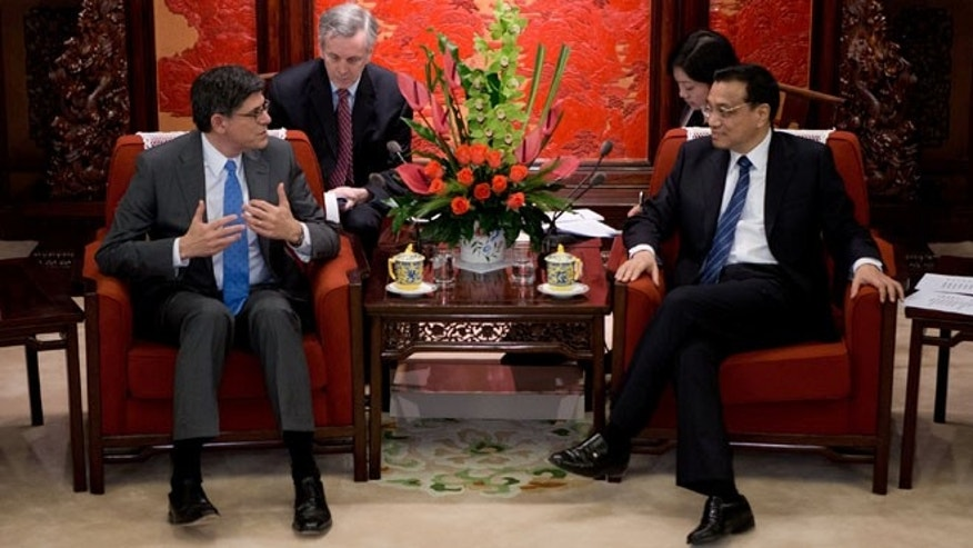 March 20, 2013: U.S. Treasury Secretary Jacob Lew, left, speaks with Chinese Premier Li Keqiang during their meeting at the Zhongnanhai diplomatic compound in Beijing. Lew has stressed China's and America's shared interest in ensuring global economic growth in the meeting.