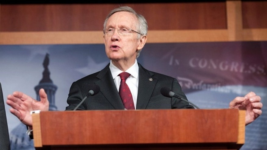 March 14, 2013: Senate Majority Leader Harry Reid, D-Nev., speaks with reporters on Capitol Hill in Washington.