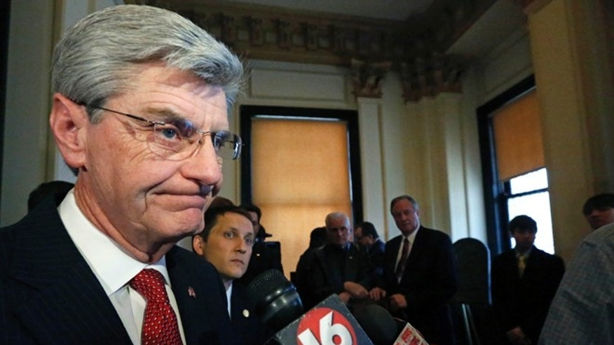 "March 14, 2013: Gov. Phil Bryant informs reporters at the Capitol in Jackson, Miss., that he'll sign a new law to prevent cities or counties from banning extra-large soft drinks or requiring restaurants to list calorie counts on menus since he opposes local restrictions on food labeling or portion sizes because he sees them as interference into private business practices. ""I'm very supportive of anything that will stop the nanny state,"" Bryant said. (AP)"