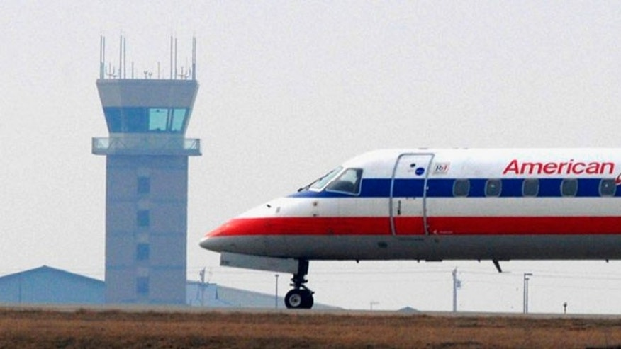 March 9, 2010: In this photo, an American Eagle flight waits for release from the air traffic control tower at Central Illinois Regional Airport in Bloomington, Ill.