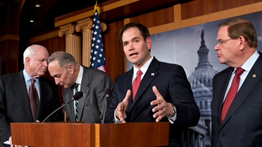 Jan. 28, 2013: Sen. Marco Rubio, R-Fla., center, speaks at a Capitol Hill news conference with a bipartisan group of leading senators to announce their agreement on the principles of sweeping legislation to rewrite the nation's immigration laws.
