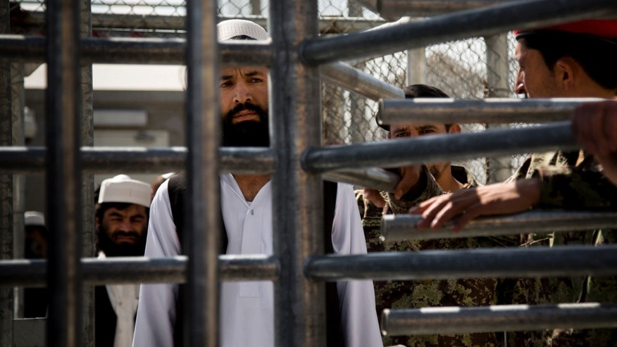 March 25, 20013: An Afghan prisoner waits in line for his release from Parwan Detention Facility after the U.S. military gave control of its last detention facility to Afghan authorities in Bagram, outside Kabul, Afghanistan.