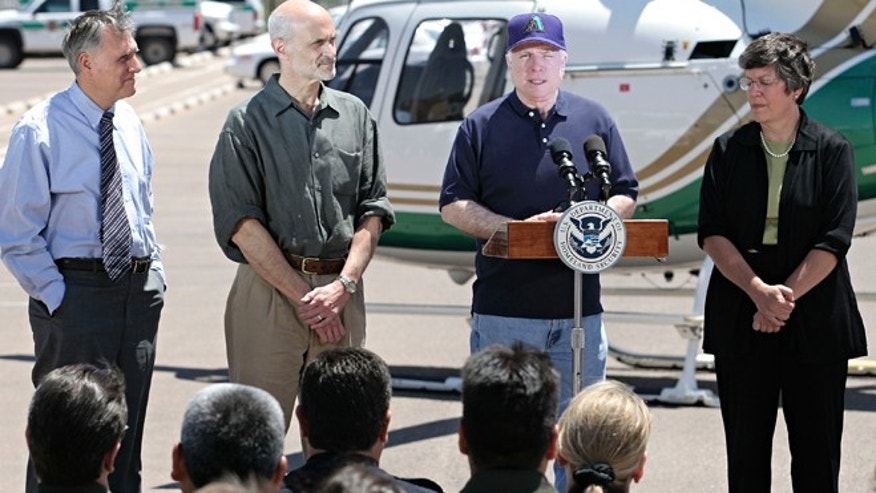 DOUGLAS, AZ - MAY 5:  U.S. Senator John McCain (R-AZ.) (Center-R) introduces U.S. Secretary of Homeland Security Michael Chertoff (Center-L) at the U.S. Border Patrol Station May 5, 2005 in Douglas, Arizona. Chertoff toured the border at Douglas and Yuma, Arizona and U.S. Border Patrol facilities along with U.S. Senator John McCain (R-AZ.), U.S. Senator Jon Kyl (R-AZ.) and Arizona Governor Janet Napolitano.  (Photo by Jeff Topping/Getty Images)