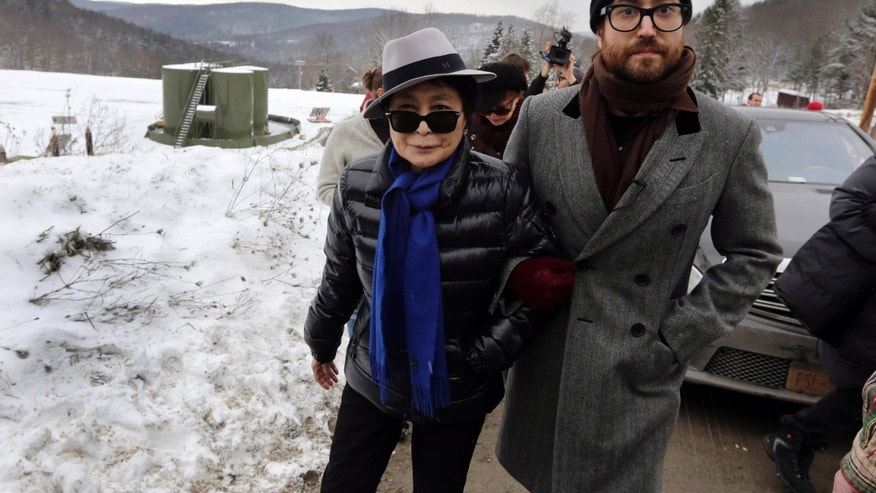 FILE: Jan. 17, 2013, Yoko Ono, left, and son Sean Lennon visit a fracking site in Franklin Forks, Pa., during a bus tour of natural-gas drilling sites in northeastern Pennsylvania.