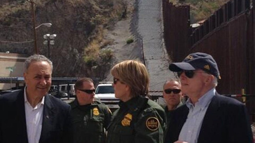 FILE: March 27, 2013: In this photo on the Twitter account of  Ariz. GOP Sen. John McCain, he and Sen. Charles Schumer, D-N.Y., left, stand with U.S. Border Patrol agents in Nogales, Ariz.