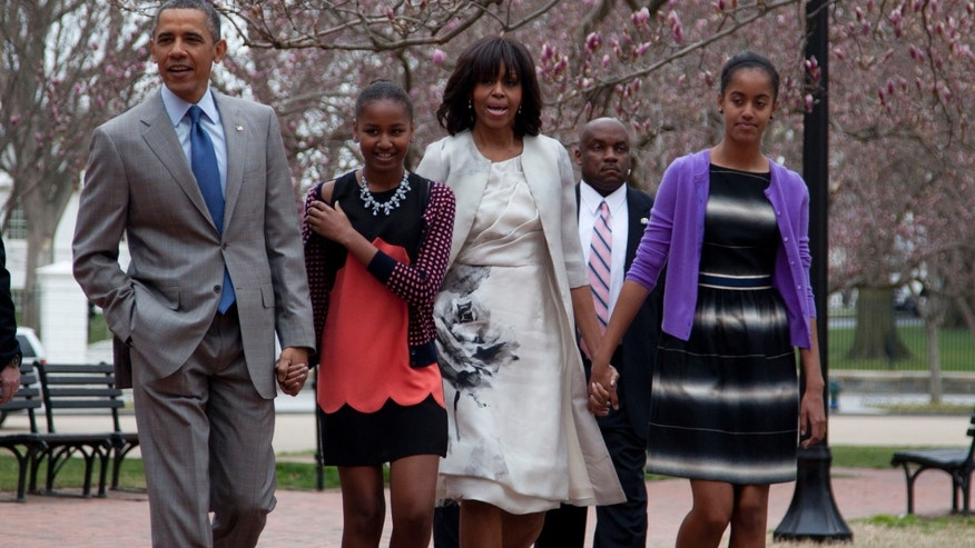 Sunday, March 31, 2013: President Obama and first lady Michelle Obama walk from the White House with their daughters, Sasha, second from left, and Malia, to St. John's Episcopal Church in Washington.