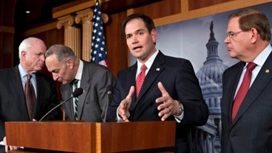 FILE: Jan. 28, 2013:  Sen. Marco Rubio, R-Fla., center, on Capitol Hill with a bipartisan group of  senators to announce their agreement on the principles of  immigration laws, Washington, D.C.