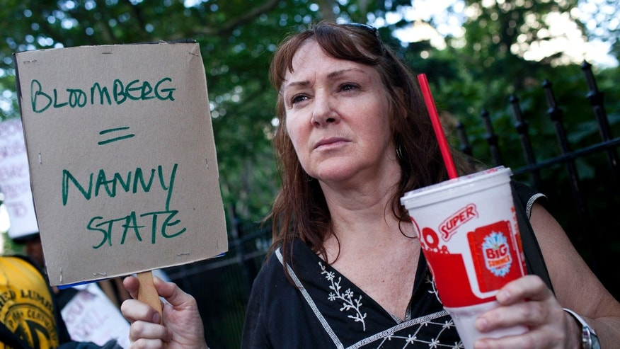 FILE: July 9, 2012: Andrea Hebert of New York, protested the proposed soda-ban that New York City Mayor Michael R. Bloomberg has suggested, outside City Hall in New York.