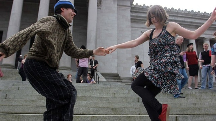 April 1, 2013: Melissa Petersen and Kevin Buster dance on the steps of the Capitol in Olympia, Wash.