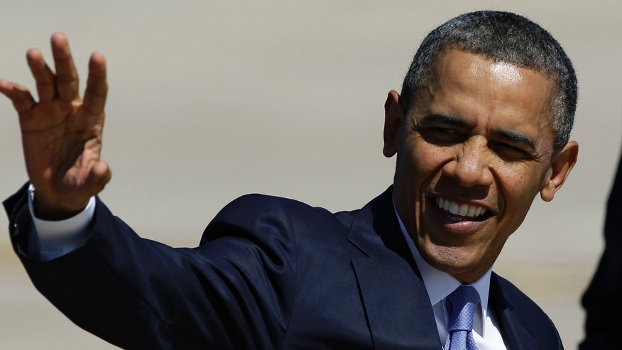 FILE: April 4, 2013: President Obama waves after his arrival at Buckley Air Force Base, Colo.