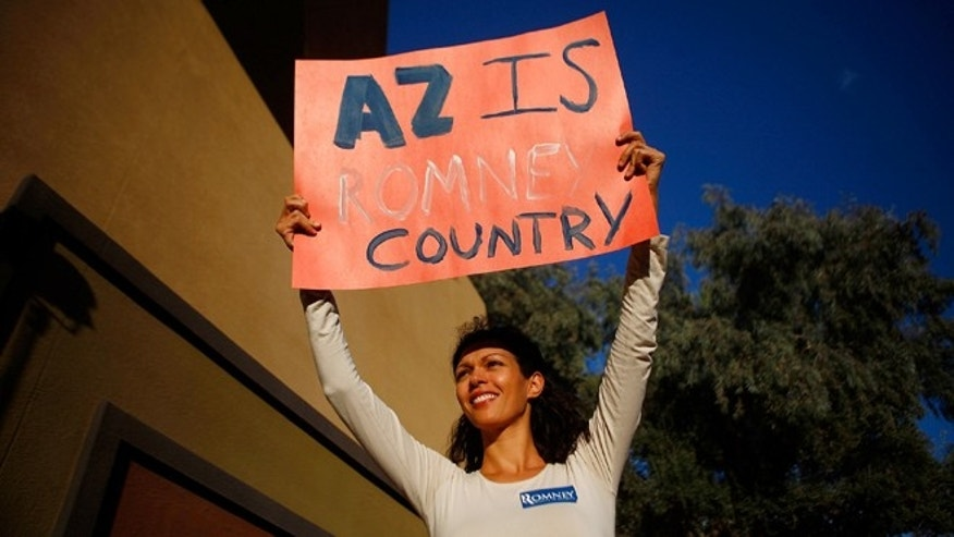 MESA, AZ - FEBRUARY 13:  A supporter holds up a sign before Republican presidential candidate, former Massachusetts Gov. Mitt Romney attends a Get out the Vote Rally February 13, 2012 in Mesa, Arizona. Romney spoke to a crowd of more than 2,000 people, and is the first contender to visit the state prior to the primary on February 22, 2012. (Photo by Eric Thayer/Getty Images)