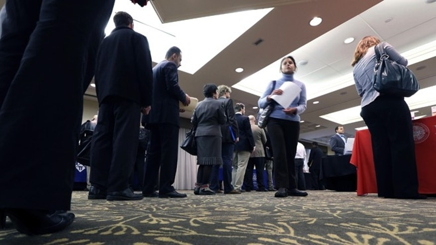 Feb. 25, 2013: Job seekers line up to speak with a State Department employee about job opportunities in the federal government during a job fair in Boston.