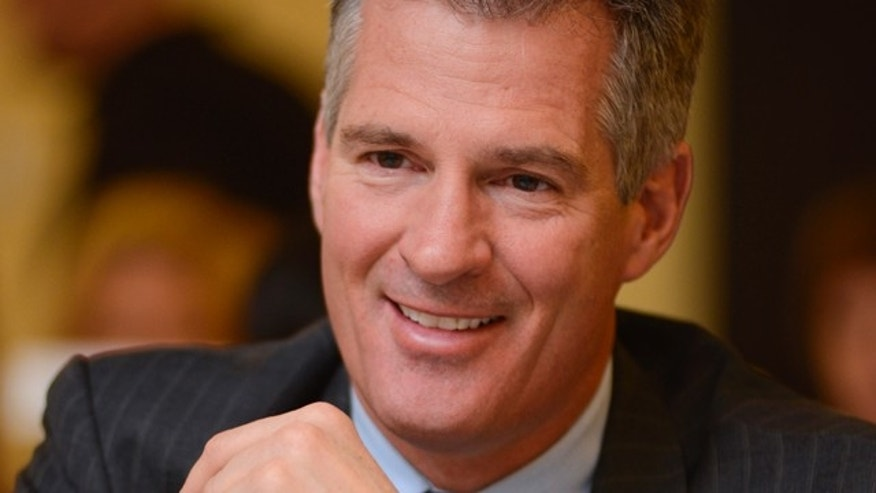 "April 4, 2013: Former U.S. Sen. Scott Brown of Massachusetts sits at a table during the 11th Annual ""Keeping the Dream Alive"" dinner commemorating the anniversary of Martin Luther King Jr.'s death."