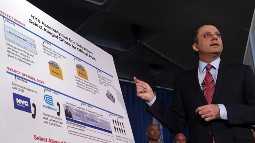 U.S. Attorney Preet Bharara gestures to a chart during a news conference in New York,  Thursday, April 4, 2013. New York state Assemblyman Eric Stevenson, a Democrat, was arrested in a bribery investigation that also led another state assemblyman charged with crimes.