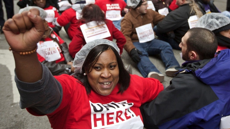 FILE: March 27, 2013: Teachers union are power in Chicago. A recent strike led to a better contract. Here they protest in front of city hall a plan to close schools 54 public schools.