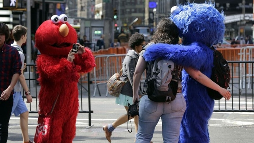 An Elmo character, in New York's Times Square, Tuesday, April 9, 2013.