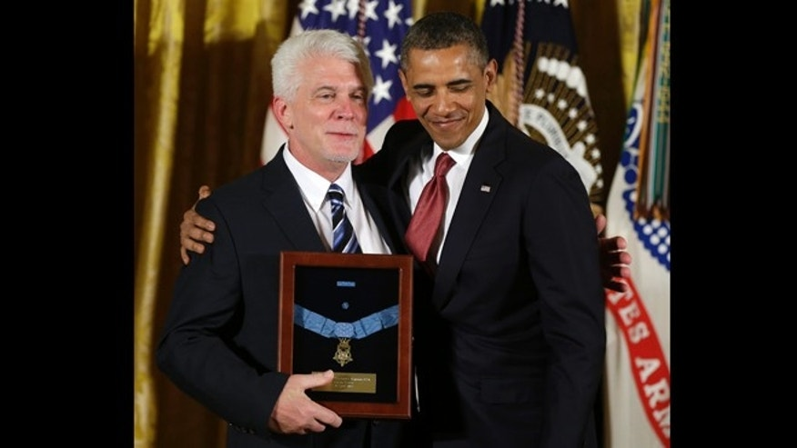 April 11, 2013: President Barack Obama stands with Ray Kapaun, nephew of Chaplain (Captain) Emil J. Kapaun, U.S. Army, as he awards the Medal of Honor posthumously to Chaplain Kapaun in the East Room of the White House in Washington.