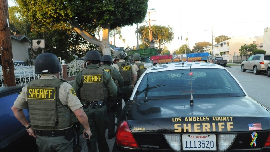 "FILE: Feb. 9, 2011: The Los Angeles County Sheriff's Department --which supports California lawmakers' efforts to stop 'swatting"" -- prepares to serve search warrants in Los Angeles, Calif."