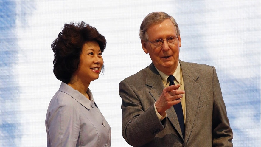 FILE: Senate Minority Leader Mitch McConnell, R-Ky., and his wife, former Labor Secretary Elaine Chao at the Republican National Convention in Tampa, Fla.
