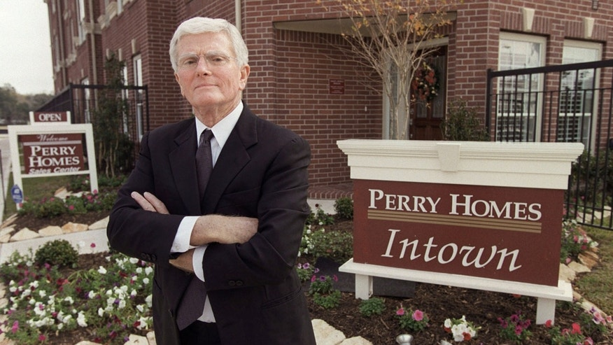 This is a Dec. 10, 2002 file photo of Houston homebuilder Bob Perry, posing at the sales center at one of his Houston developments.