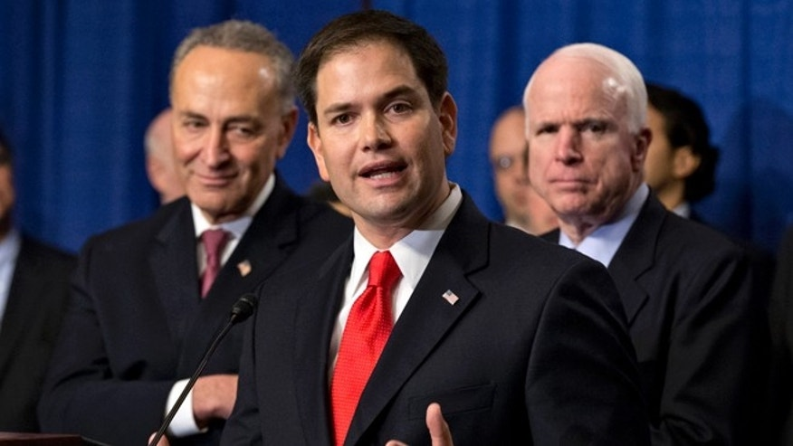 April 18, 2013: Sen. Marco Rubio, R-Fla., flanked by Sen. Charles Schumer, D-N.Y., left, and Sen. John McCain, R-Ariz., right, speaks about immigration legislation.