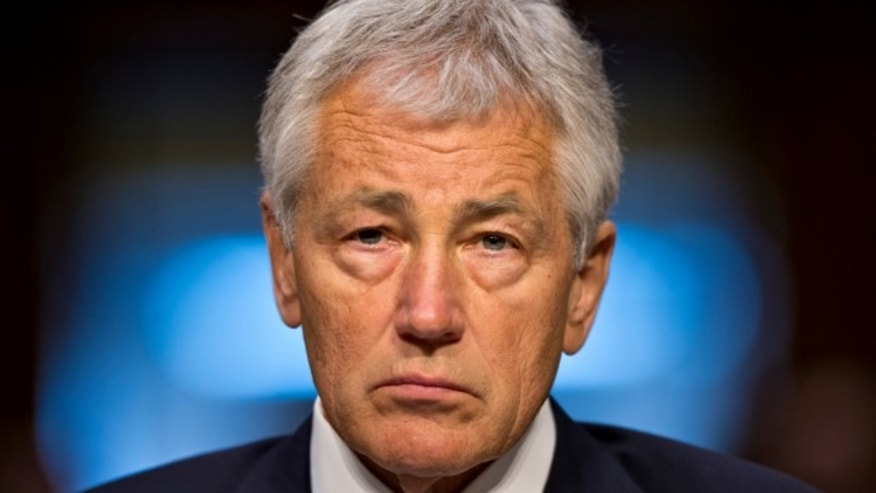 April 17, 2013: Defense Secretary Chuck Hagel listens prior to testifying on Capitol Hill in Washington.