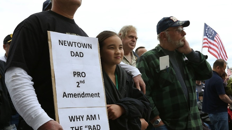 Bill Stevens of Newton Conn. and his daughter Victoria, 10,  listen to the speakers during a gun rights rally at the Connecticut State Capitol in Hartford Conn. on Saturday April 20, 2013.  The Connecticut Citizens Defense League , the National Rifle Association and Coalition of Connecticut Sportsmen are joining forces to challenge the new gun control legislation recently passed by the Connecticut General Assembly after the Newtown school shooting. Among other things, the law expands Connecticut's assault weapons ban and bans large capacity ammunition magazines. (AP Photo/Journal Inquirer, Jared Ramsdell)   MANDATORY CREDIT