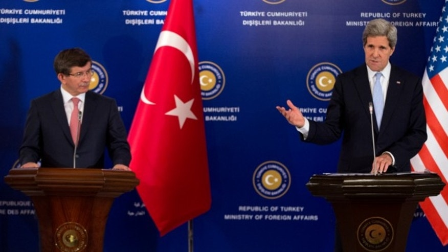 "April 21, 2013: U.S. Secretary of State John Kerry, right, speaks during a news conference with Turkish Foreign Minister Ahmet Davutoglu, left, and Syrian opposition leader Moaz al-Khatib, not pictured, after a ""Friends of Syria"" group meeting at the Adile Sultan Palace in Istanbul, Turkey."