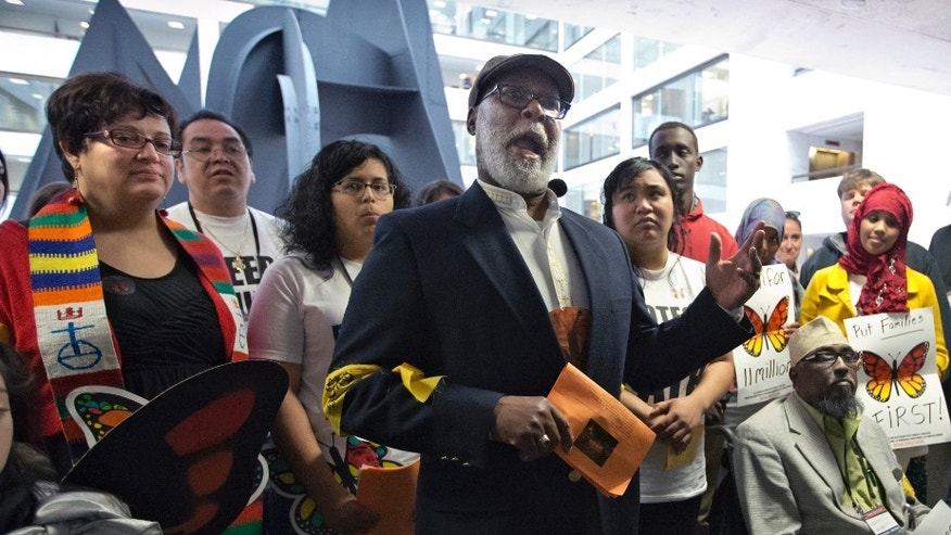 Monday, April 22, 2013: The Rev. Eugene Barnes of Illinois, joins immigration advocates outside the Senate Judiciary Committee hearing on immigration reform on Capitol Hill, in Washington, D.C.