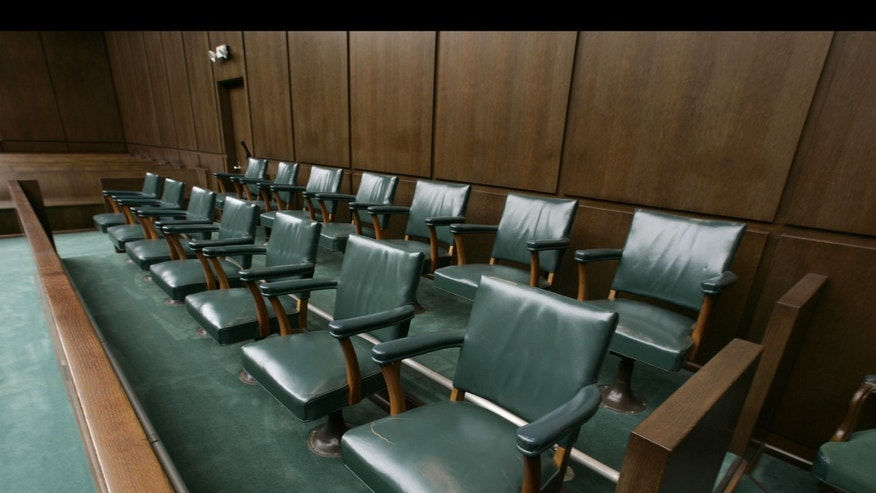 ** FILE **The jury box in Judge Sim Lake's courtroom at the Robert Casey Federal Courthouse is shown in a file photo from Jan. 11, 2006, in Houston. (AP Photo/Brett Coomer, Pool, File)