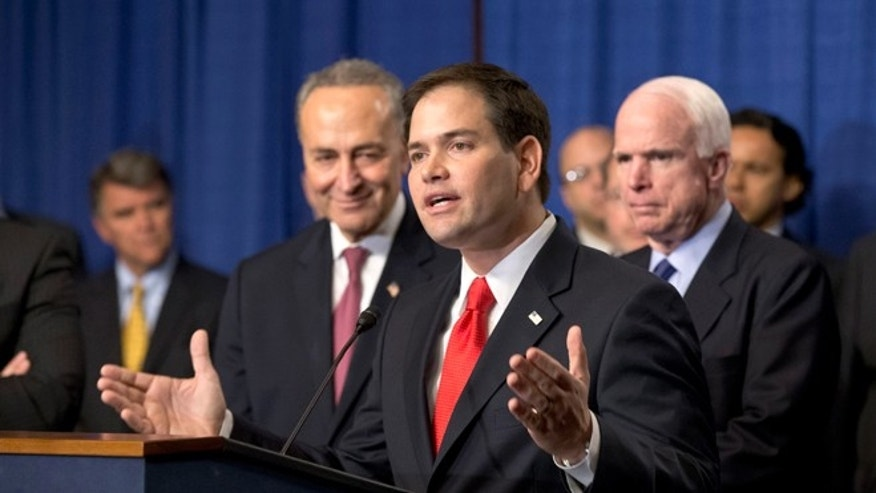 "Sen. Marco Rubio, R-Fla., flanked by Sen. Charles Schumer, D-N.Y., left, and Sen. John McCain, R-Ariz., right, speaks as immigration reform legislation by the Senate's bipartisan ""Gang of Eight"" that would create a path for the nation's 11 million unauthorized immigrants to apply for U.S. citizenship, Thursday, April 18, 2013, on Capitol Hill in Washington. (AP Photo/J. Scott Applewhite)"