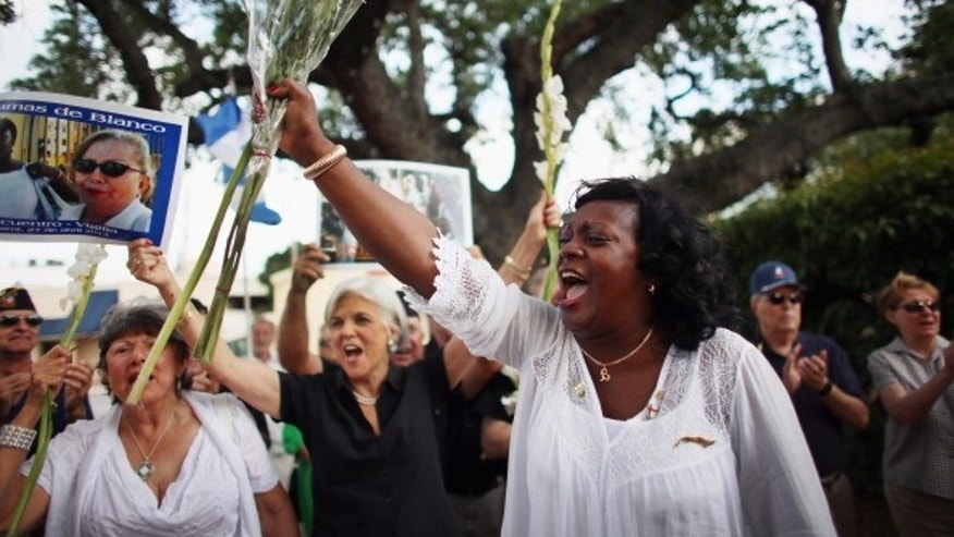 CORAL GABLES, FL - APRIL 27:  Berta Soler, co-founder of the Ladies in White,  and current leader of the Cuban opposition group leads a cheer as she visits with Cuban exiles during an event at Merrick Park on April 27, 2013 in Coral Gables, Florida. In Cuba Soler?s group is made up of wives and mothers and was formed in 2003 after the arrests of 75 government opponents.  (Photo by Joe Raedle/Getty Images)
