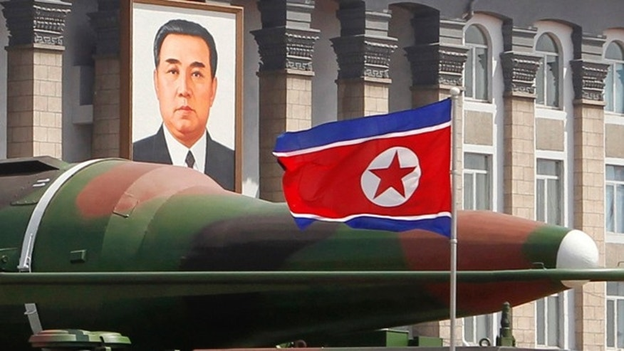 A new missile is carried during a mass military parade at the Kim Il Sung Square in Pyongyang, North Korea.