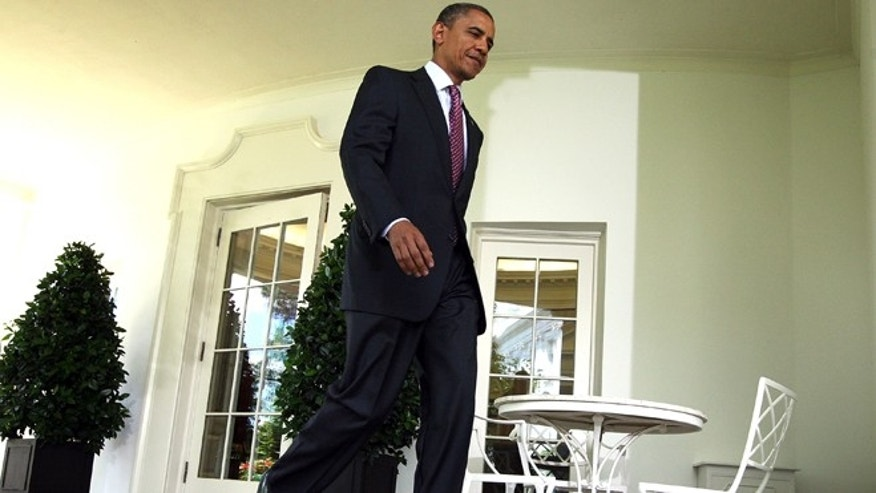 WASHINGTON, DC - JUNE 15:  U.S. President Barack Obama walks out from the Oval Office for remarks at the Rose Garden of the White House June 15, 2012 in Washington, DC. Obama said the administration will stop deporting undocumented immigrants who had come to the U.S. when they were at a young age.  (Photo by Alex Wong/Getty Images)