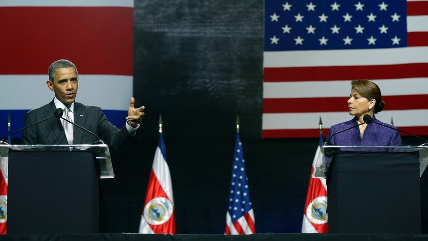 President Barack Obama, left, and speaks during a news conference with Costa Rica President Laura Chinchilla at the National Center for Art and Culture in San Jose, Costa Rica, Friday, May 3, 2013. (AP Photo/Pablo Martinez Monsivais)