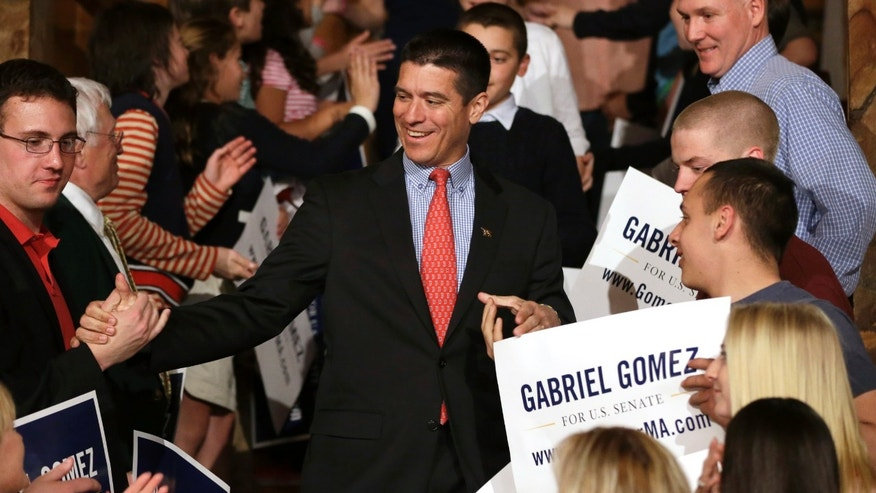 Republican candidate for the U.S. Senate, Gabriel Gomez, center, celebrates with supporters as he makes his way to the stage to address an audience with a victory speech at a watch party, in Cohasset, Mass., Tuesday, April 30, 2013. Gomez won his primary bid for the Republican nomination to contest a U.S. Senate seat, defeating Republican hopefuls Michael Sullivan and Dan Winslow. (AP Photo/Steven Senne)