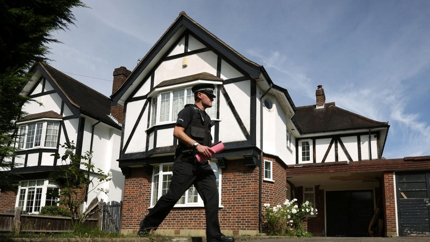 CLAYGATE, ENGLAND - SEPTEMBER 06:  A policeman stands in the garden of a house believed to be owned by a British family murdered in a shooting in the French Alps on September 6, 2012 in Claygate, England. French police are investigating a multiple murder after the bodies of three members of a British family were found in a bullet-riddled car in the French resort of Annecy. A 4-year-old girl, who had remained hidden for hours, was also found alive after investigators eventually entered the car. Local news agencies have named the male victim as Saad al-Hilli.  (Photo by Peter Macdiarmid/Getty Images)