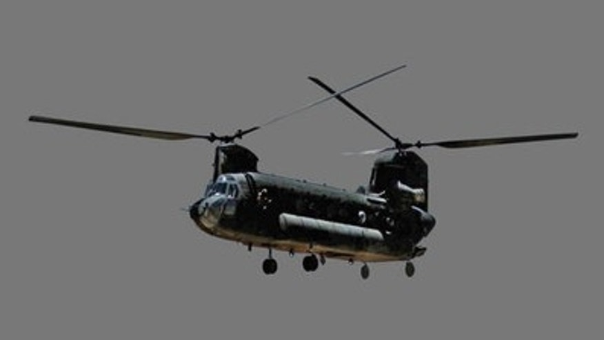 File: A US Army CH-47D Chinook helicopter in flight.