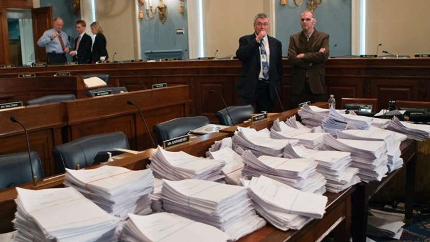 May 15, 2013: Stacks of paperwork await members of the House Agriculture Committee, on Capitol Hill in Washington, as it meets to consider proposals to the 2013 Farm Bill, including small cuts to the $80 billion-a-year food stamp program in an effort to appease conservatives who say the food aid has become too expensive.