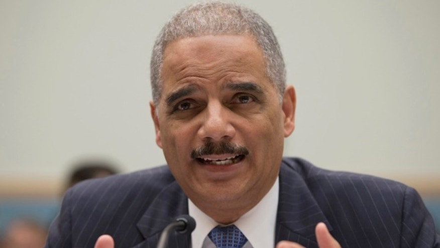 May 15, 2013: Attorney General Eric Holder gestures while testifying on Capitol Hill in Washington.